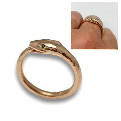 Rose gold ouroboros ring with green diamond eyes, custom created ring